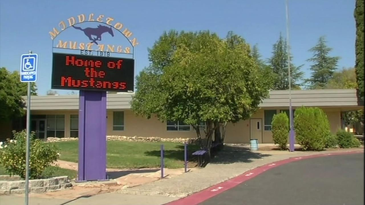 A sign in front of Middletown High School in Middletown, Calif. flashes Home of the Mustangs.