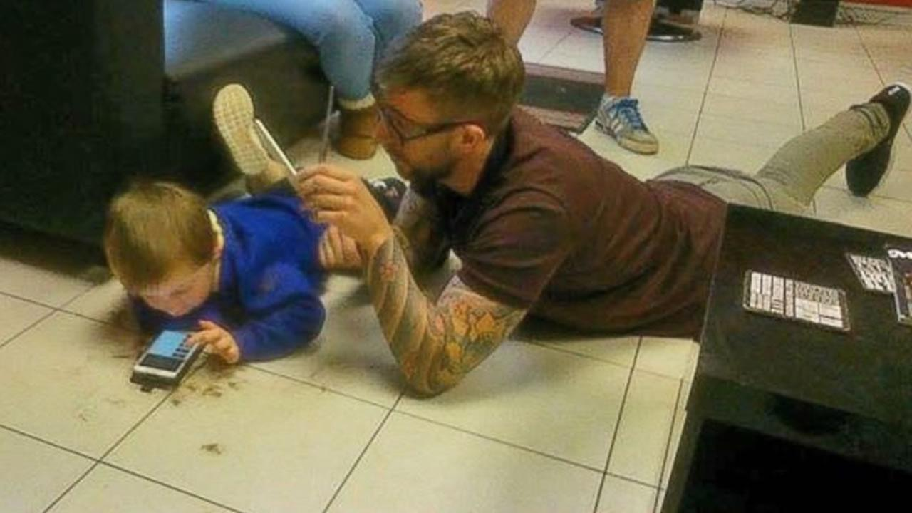 Photos of a British barber giving a young boy with autism a haircut have gone viral.
