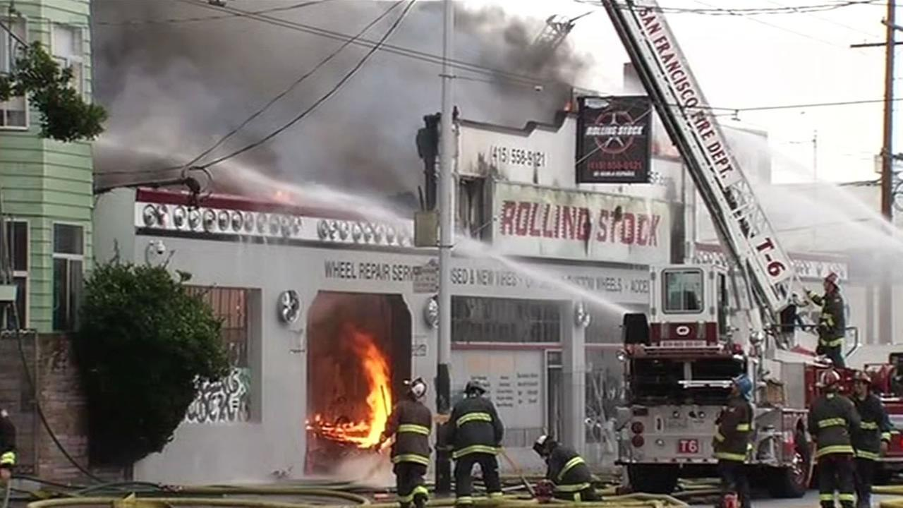 A fire consumed a tire store at 16th and Shotwell streets in the Mission District on Sunday, November 8, 2015.
