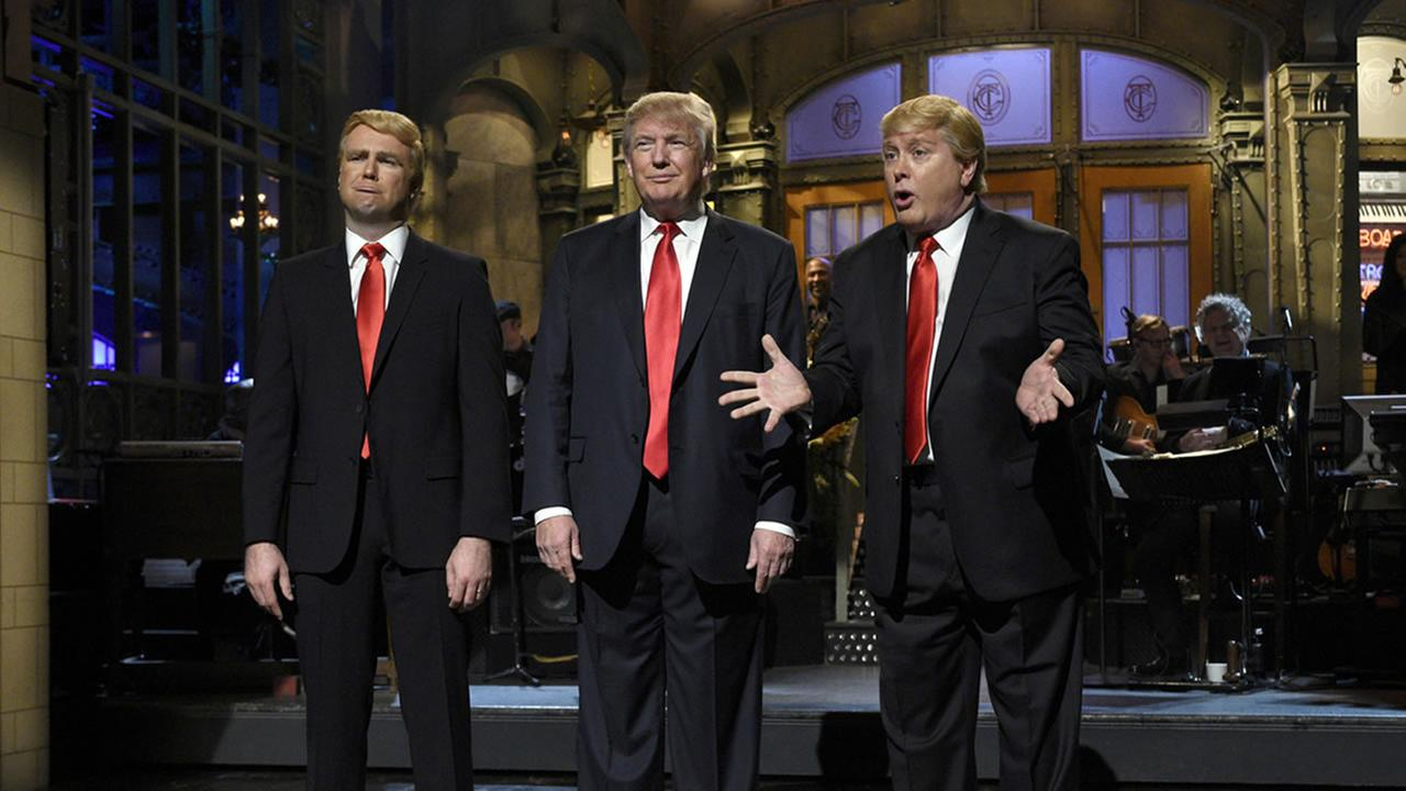 Taran Killam, left, Republican presidential candidate and guest host Donald Trump, center, and Darrell Hammond perform during the monologue on Saturday Night Live.