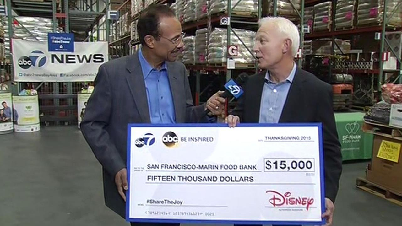 On behalf of ABC7 and Disney, Spencer Christian presented a check to SF-Marin Food Bank executive director Paul Ash on Monday, November 9, 2015.