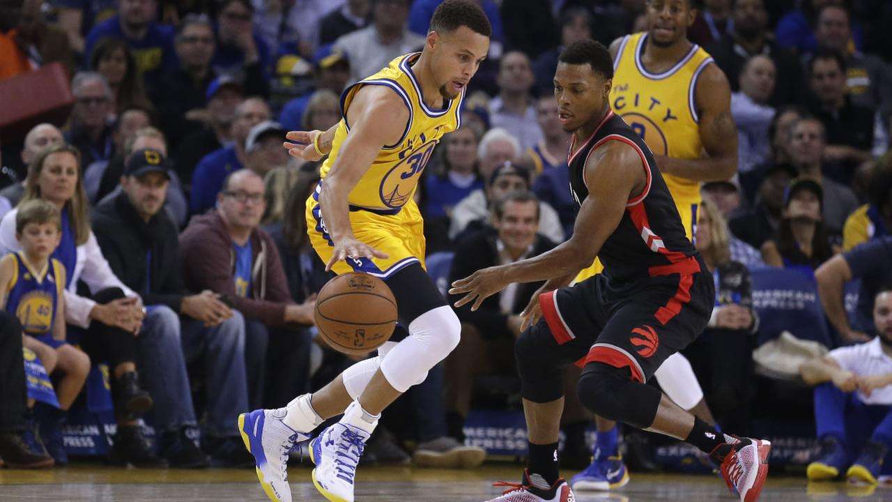 Golden State Warriors Stephen Curry, left, drives the ball against Toronto Raptors during the first half of an NBA basketball game Tuesday, Nov. 17, 2015, in Oakland, Calif.