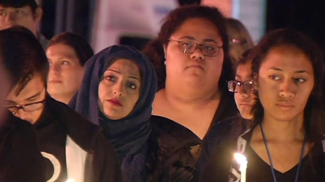 Lubna Hussain of Foster City attends candlelight vigil