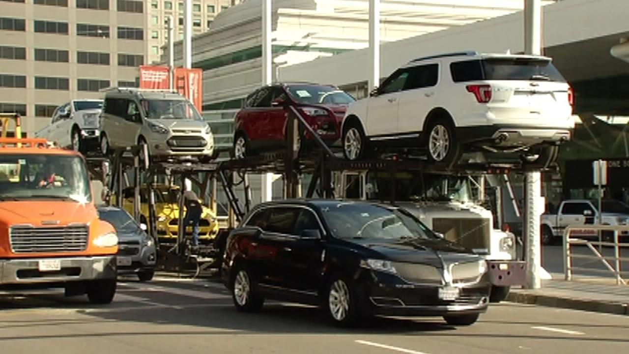 Cars, trucks and SUVs were offloaded at Moscone Center in San Francisco on Friday, November 20, 2015 for the International Auto Show.