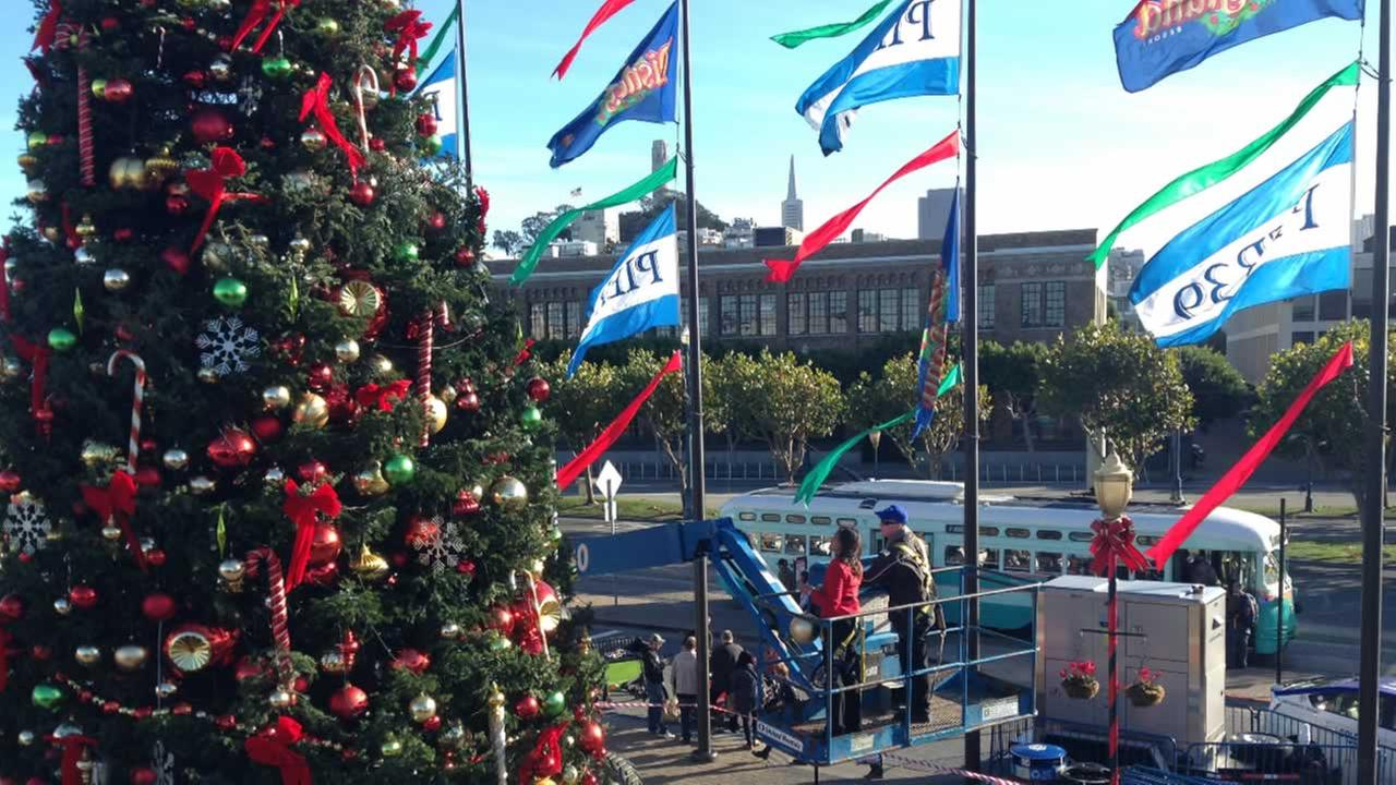 ABC7 News Anchor Ama Daetz places an ornament on the tree at Pier 39 in San Francisco on Saturday, November 21, 2015.