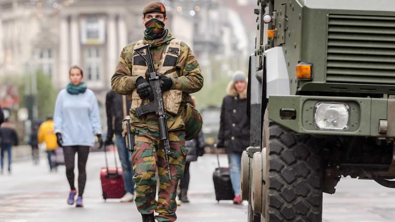 A Belgian Army soldier patrols on a main boulevard in Brussels, Sunday, Nov. 22, 2015.