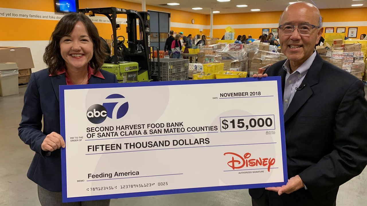 ABC7s David Louie presents a check for $15,000 to Second Harvest Food Bank in San Jose, Calif. on Thursday, Nov. 1, 2018.