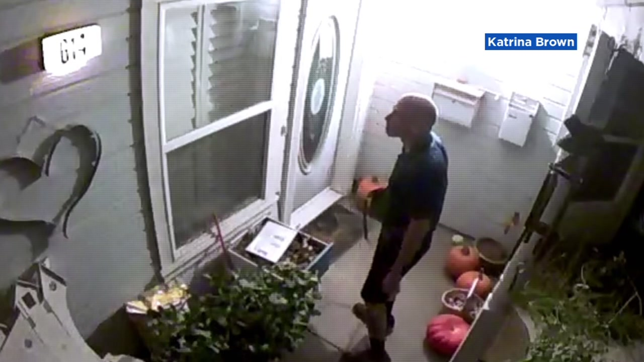 Video shows a man holding Katrina Browns purse, ringing her doorbell on Wednesday, Oct. 31, 2018.