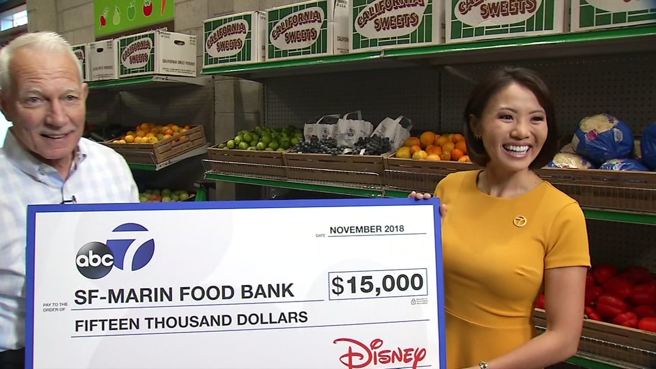 ABC7s Dion Lim presents a check for $15,000 to San Francisco-Marin Food Bank in San Francisco, Calif. on Friday, Nov. 2, 2018.
