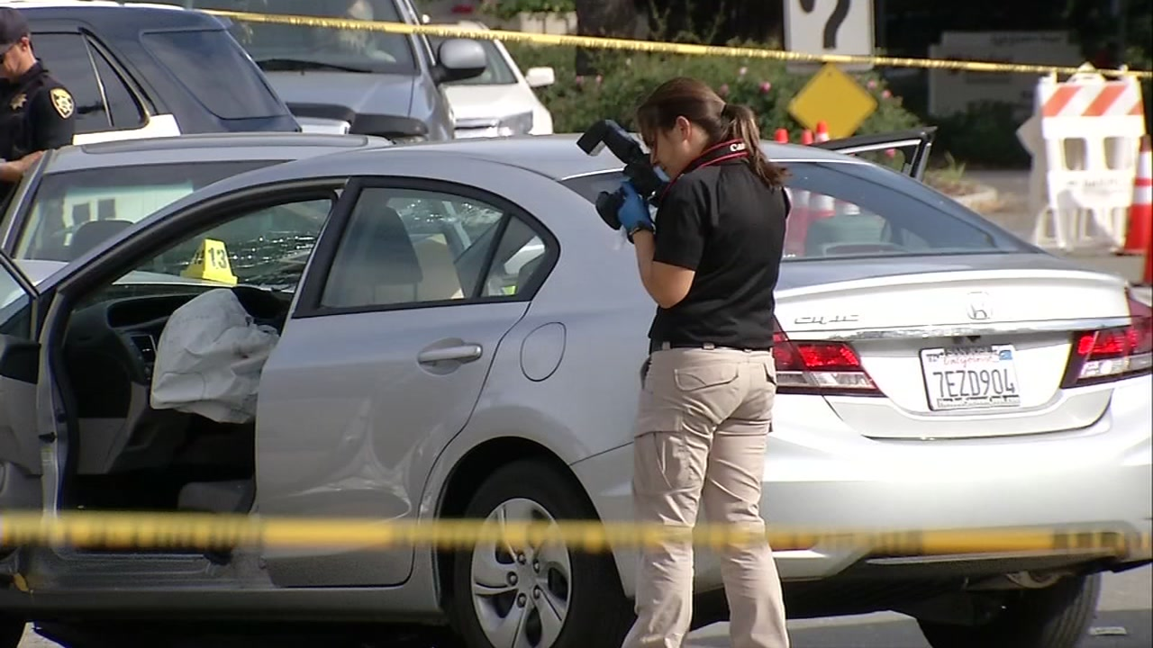Police gather evidence at the scene where an officer shot and killed a suspect in Danville, Calif., on Nov. 3, 2018.