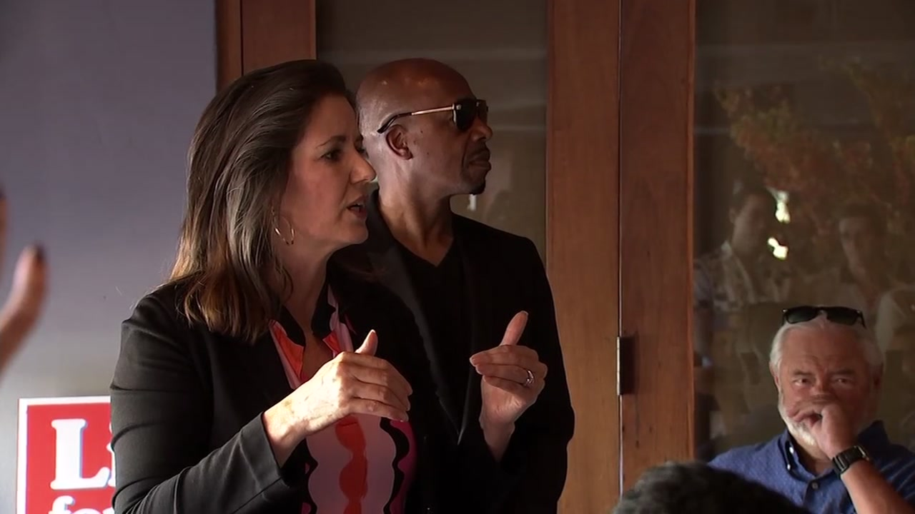 Mayor Libby Schaaf and MC Hammer are seen in Oakland, Calif. on Sunday, Nov. 4, 2018.