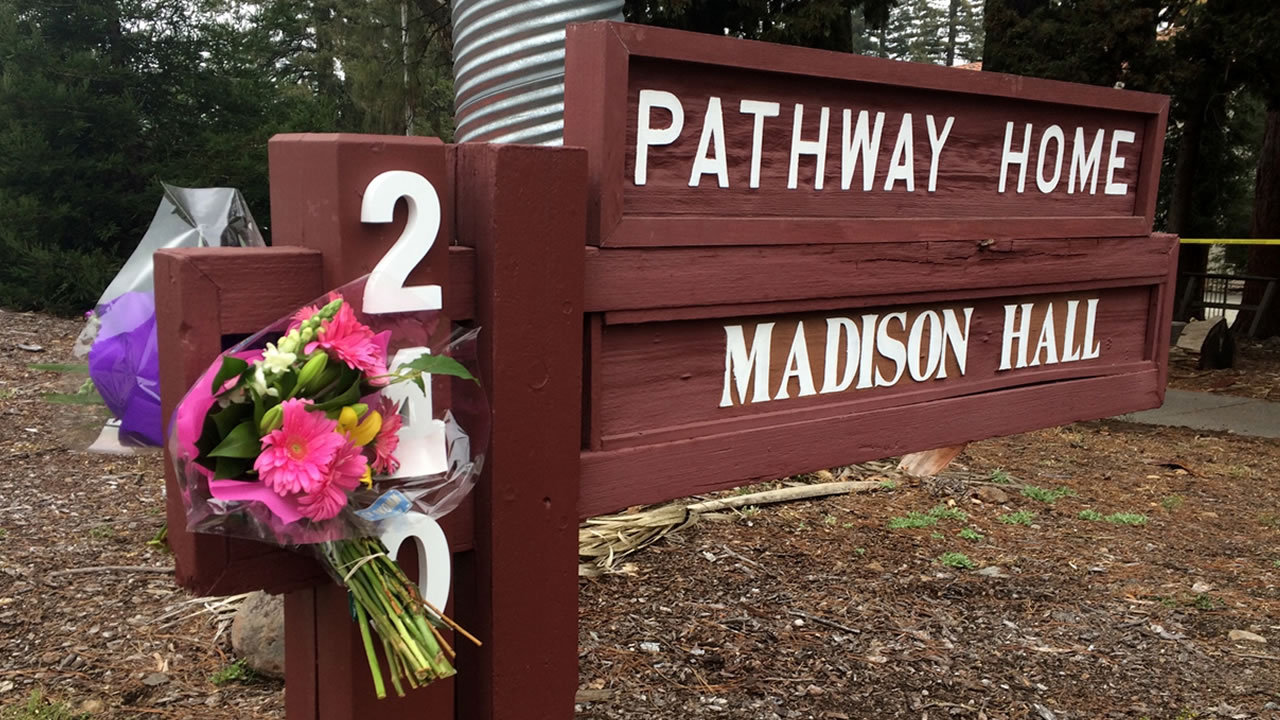 In this March 10, 2018, file photo, flowers adorn the sign in front of Pathway Home a day after a deadly shooting in Younteville, Calif.