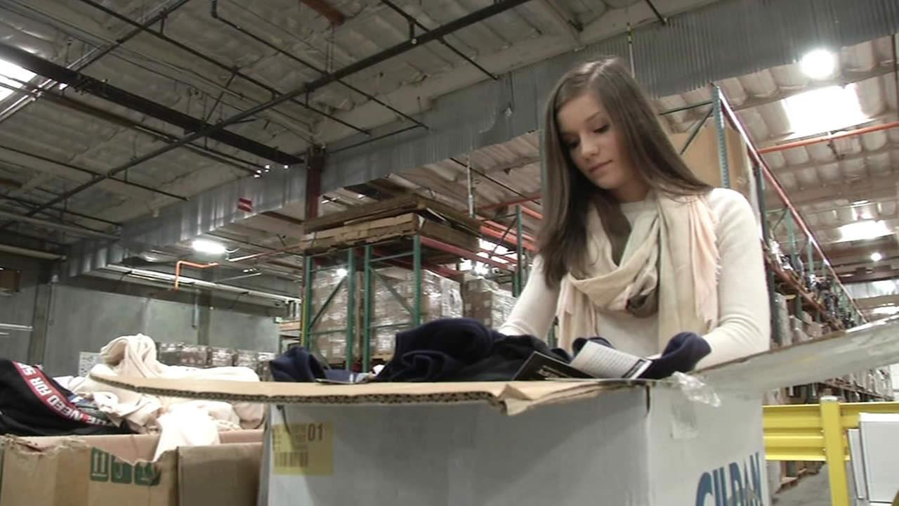 Saint Ignatius High School student Julia Tognotti collects clothing and toiletries for children detained while illegally trying to cross into the U.S.