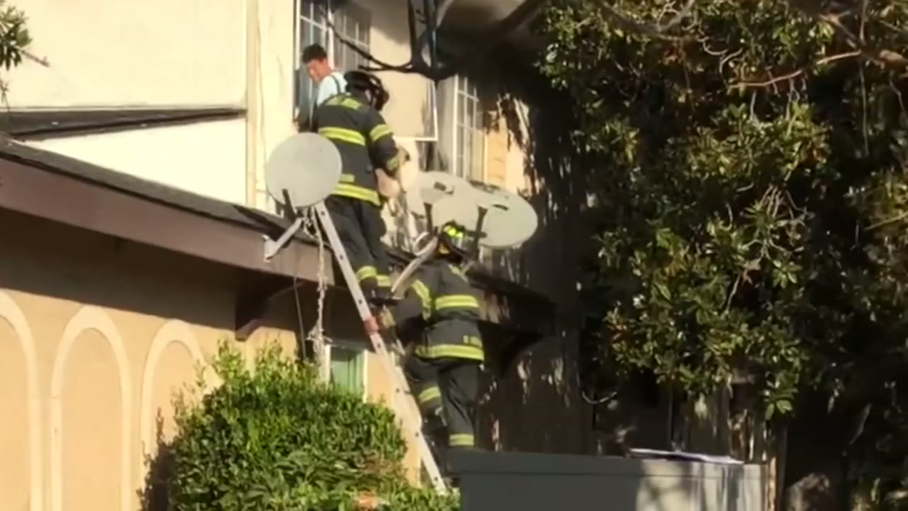 Video shows firefighters rescuing a person from a burning apartment building in San Jose, Calif. on Wednesday, Nov. 7, 2018.