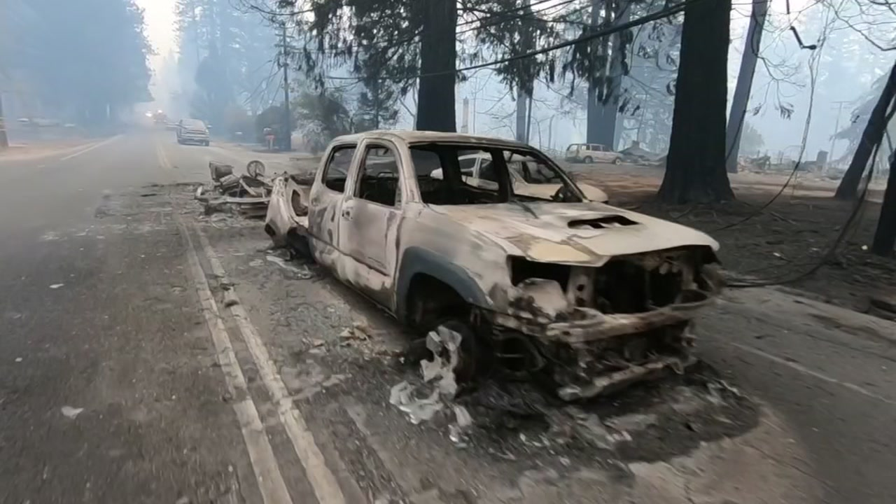Burned cars abandoned because of the Camp Fire litter a road Paradise, Calif., on Nov. 9, 2018.