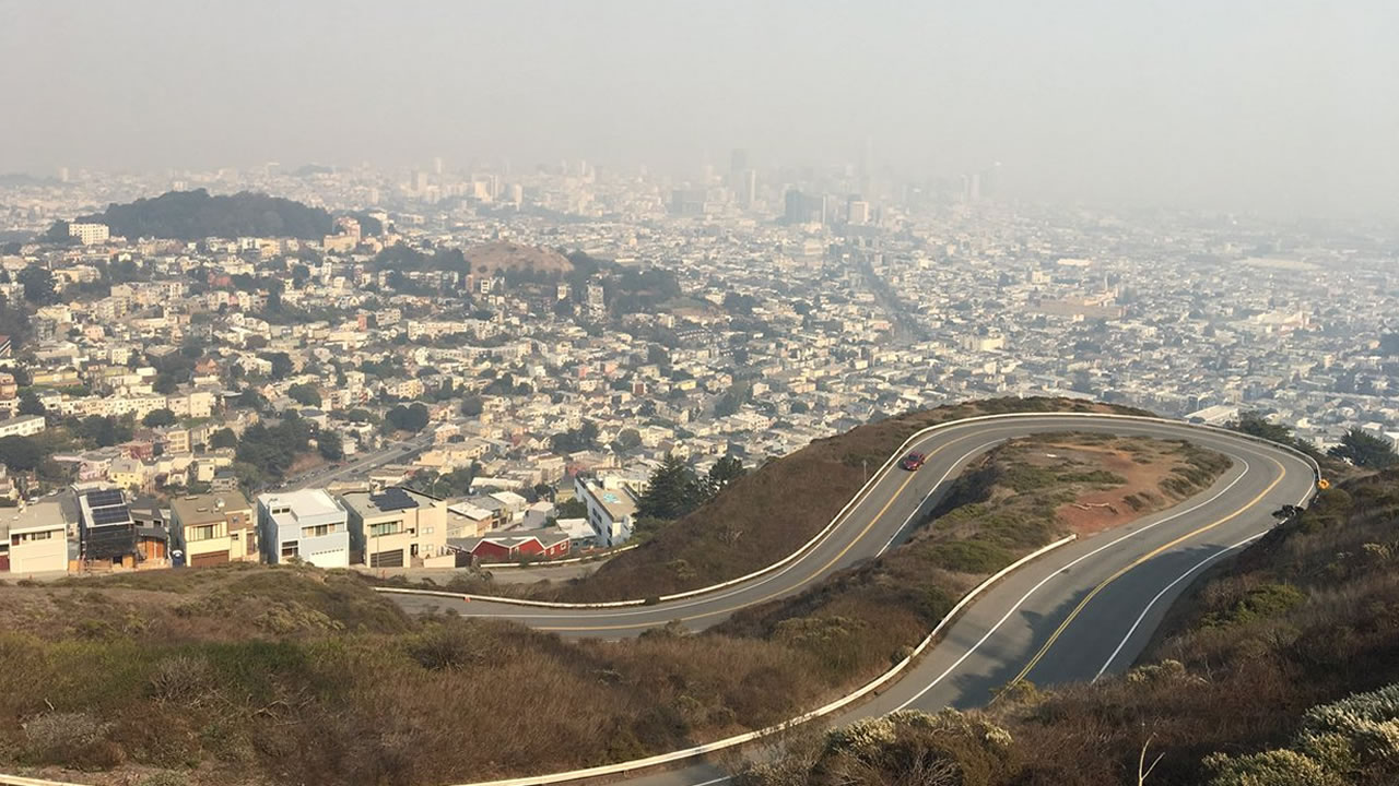 The view of San Francisco from Twin Peaks is obscured by hazy, smokey skies on Friday, Nov. 9, 2018.