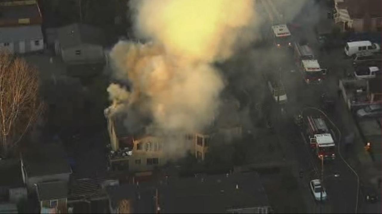 Firefighters battle two-alarm fire on 600 block of Clara Street in Oakland, Friday, December 4, 2015.