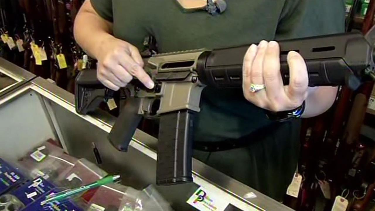 Jeana Rolsky-Feige of Imbert and Smithers in San Carlos, Calif. shows ABC7 News an assault rifle that is legal in California on Friday, December 4, 2015.