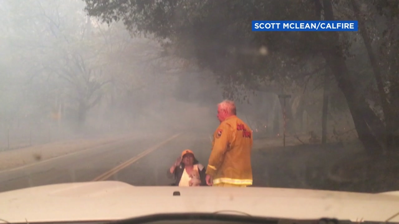 A video from Butte County shows first responders rescuing a woman in a wheelchair.