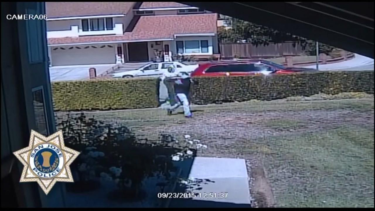 Burglary suspects are seen getting out of a red SUV in front of a San Jose, Calif. home on Sept. 23, 2015.
