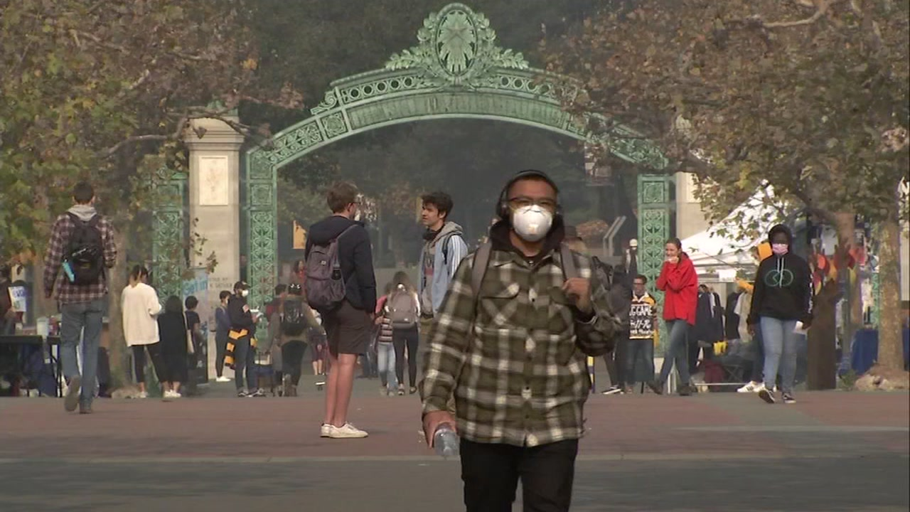 A man walks across the Cal campus while wearing a mask in Berkeley, Calif. on Thursday, Nov. 15, 2018.