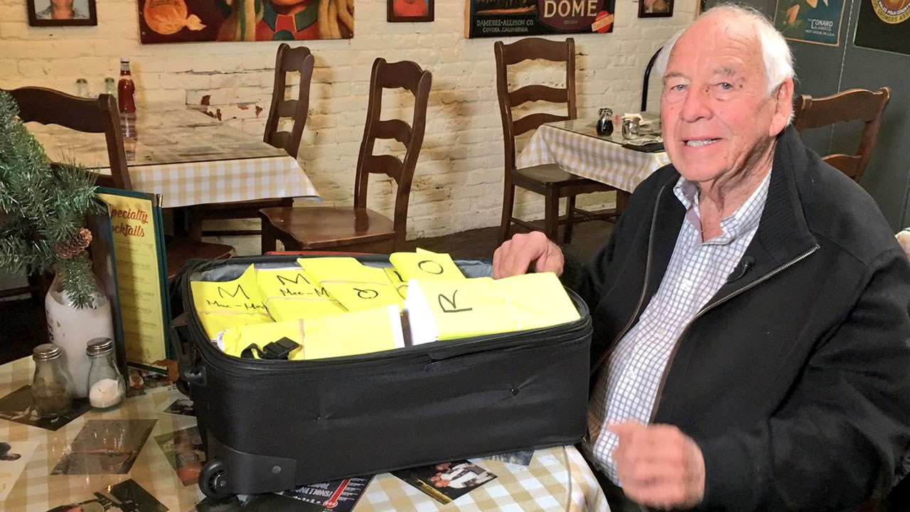 Southern California businessman Bob Wilson is seen with a suitcase full of checks in Butte County, Calif. on Tuesday, Nov. 27, 2018.