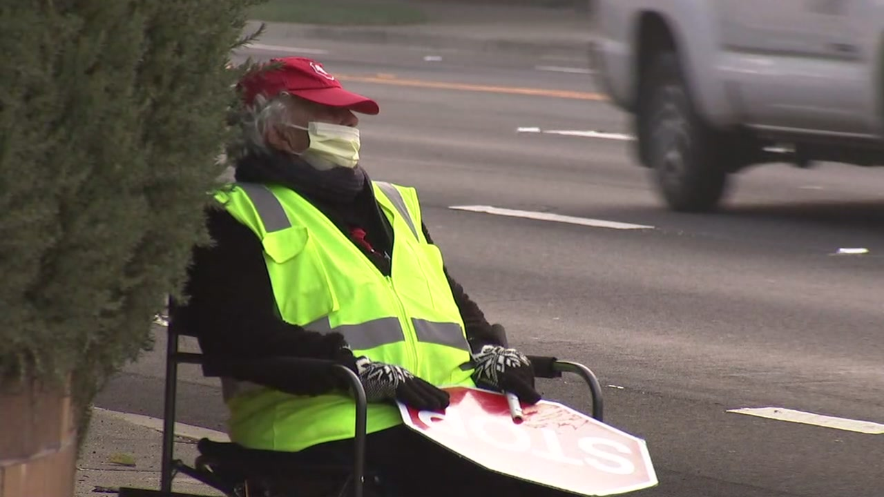 A school crossing guard wears a mask on Wednesday, Nov. 14, 2018.