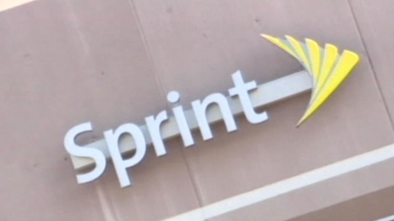 This undated photo shows a sign above a Sprint store.