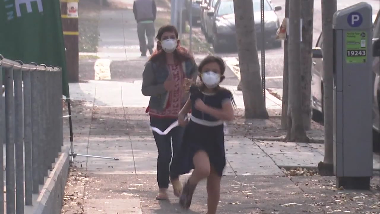 Many people in the Bay Area are toughing out the bad air by using masks.