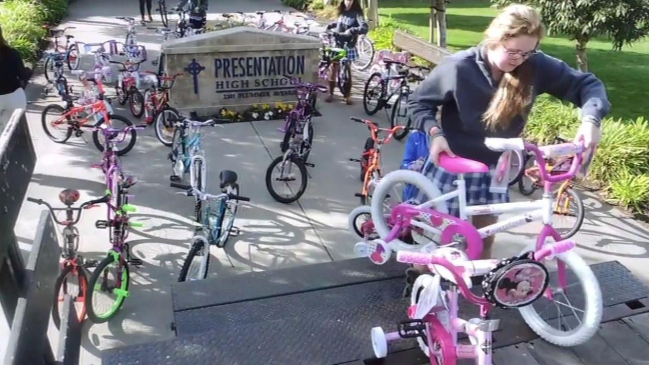 Students at Presentation High School in San Jose, Calif. are seen loading up  bicycles in a trucks to give to needy children Dec. 9, 2015.