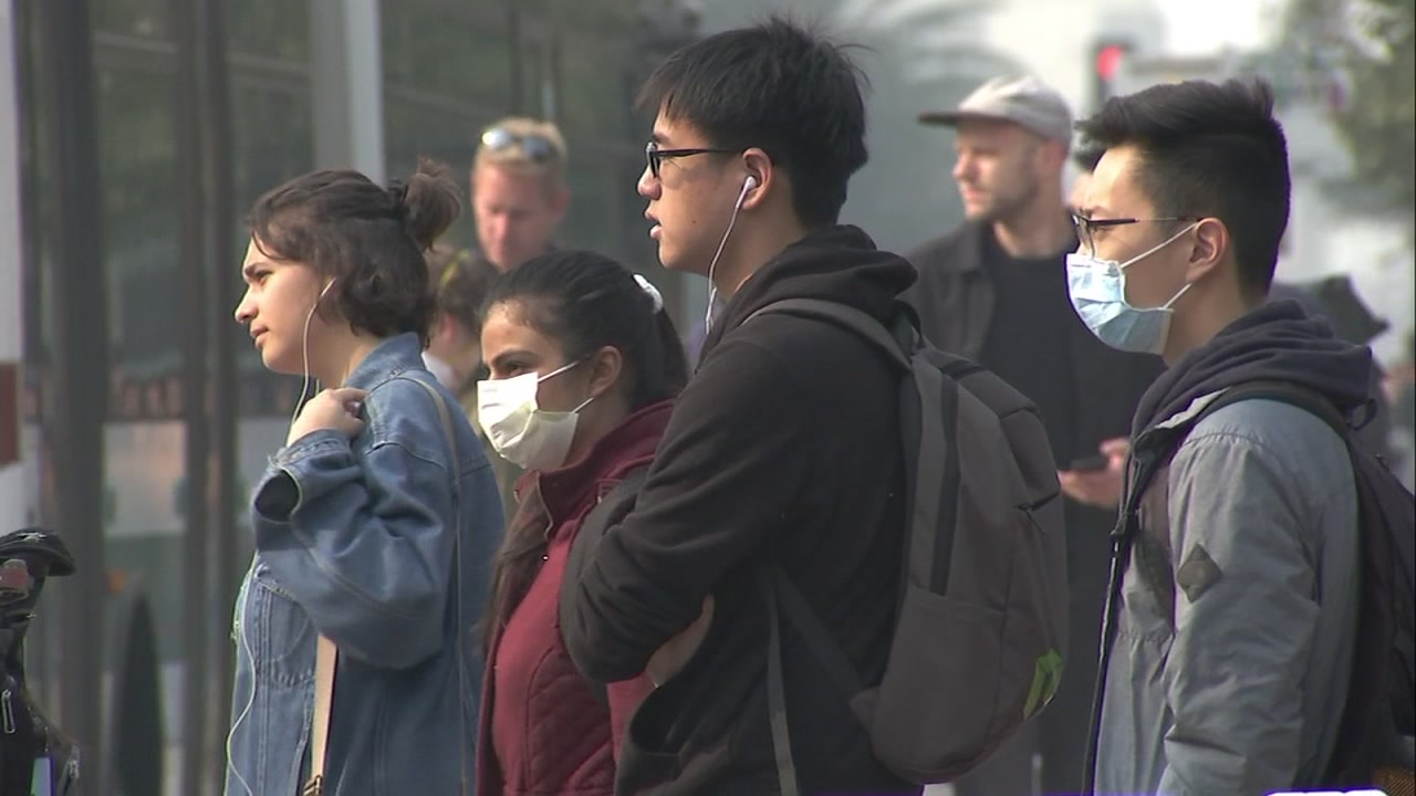 This undated image shows people in the Bay Area wearing masks as poor air quality continues across the region due to the wildfire in Butte County, Calif.