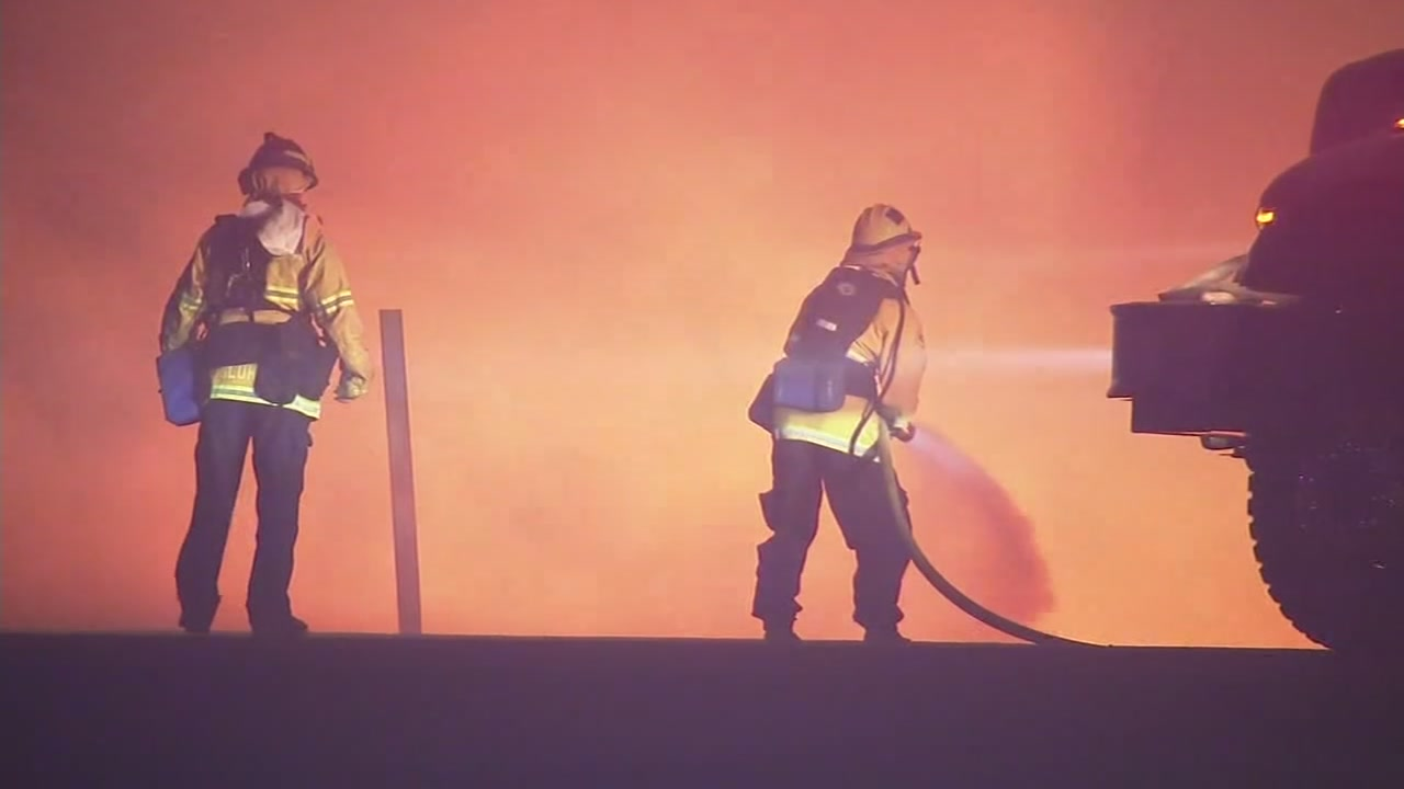 Firefighters battling fire on unknown date.