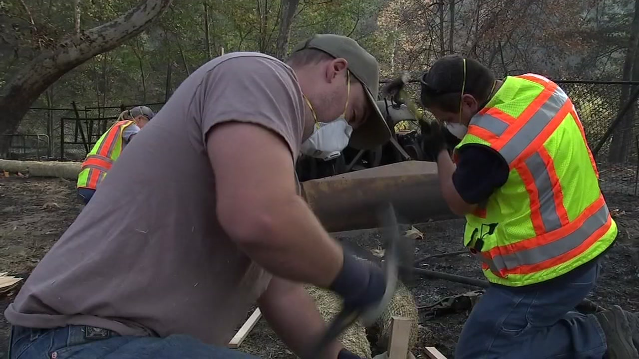 Crews In Butte County working to make sure the rain doesnt spread contaminated ash into the environment on Nov. 20, 2018.