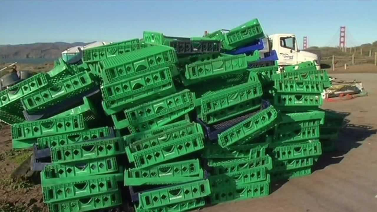 Stacks of green and blue pallets washed ashore at San Franciscos Baker Beach on Sunday, Dec. 14, 2015 after being knocked off a ship in rough seas.