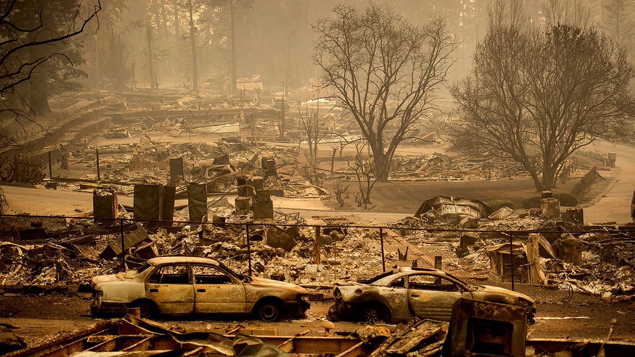 Homes leveled by the Camp Fire line a development on Edgewood Lane in Paradise, Calif., Monday, Nov. 12, 2018.