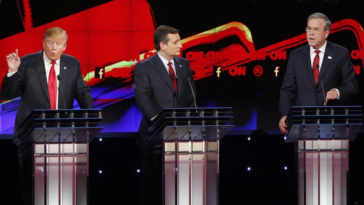 Donald Trump, Ted Cruz, and Jeb Bush are seen during the CNN Republican presidential debate at the Venetian Hotel and Casino on Dec. 15, 2015, in Las Vegas. (AP Photo/John Locher)