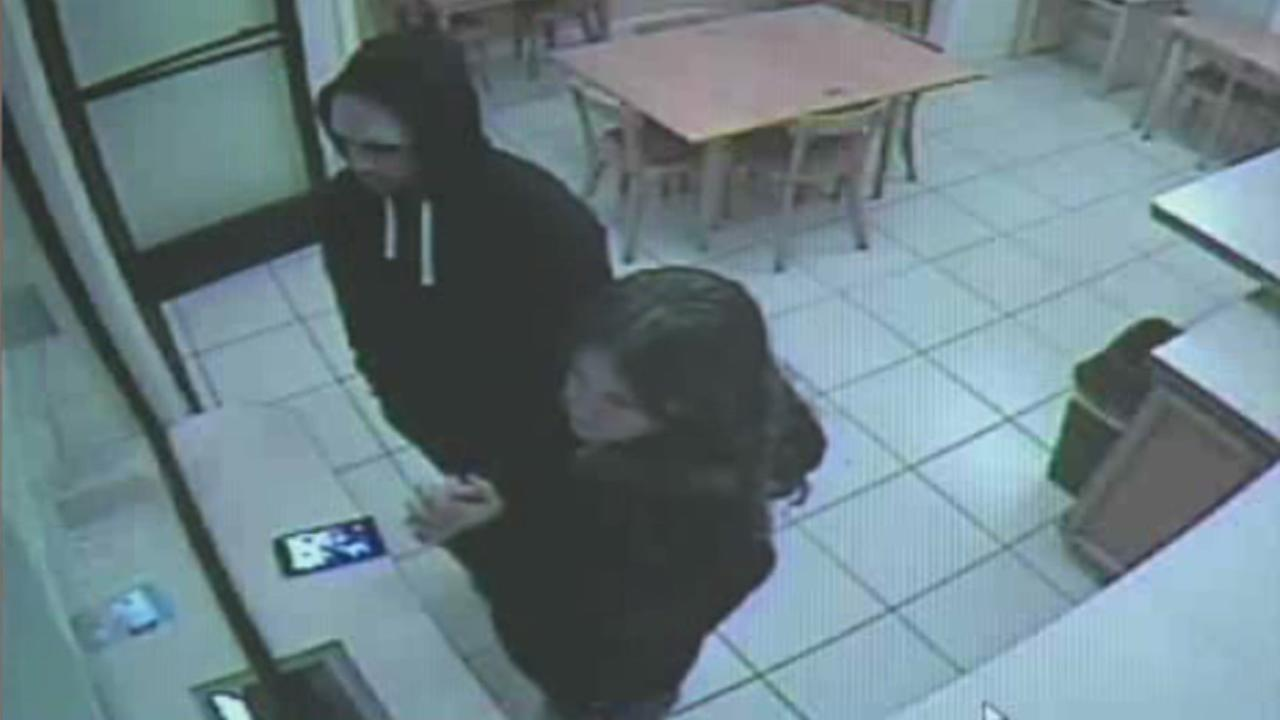 Surveillance video shows Tami Hunstman late last month in a hotel lobby with her boyfriend, but no children.