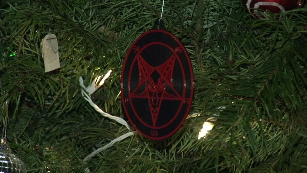 Satanic Bay Area says Christmas in the Park visitors are taking much more than time while admiring the hundreds of trees on display.