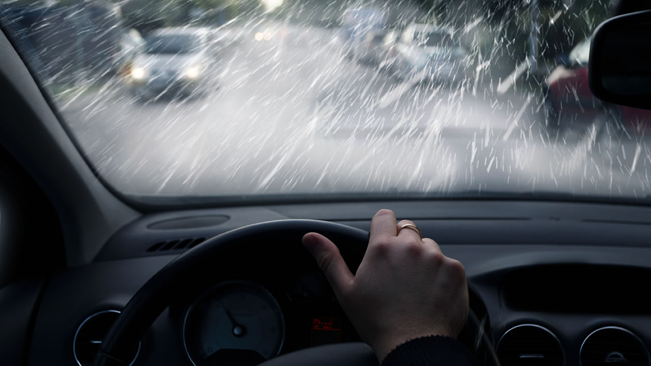A person drives in the rain in this undated file photo.