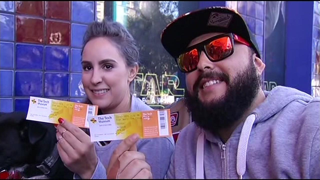 Alex Garcia and Veronica Donohue, who are big Star Wars fans, show off their tickets outside the Tech Museum in San Jose, Calif. on Thursday, December 17, 2015.