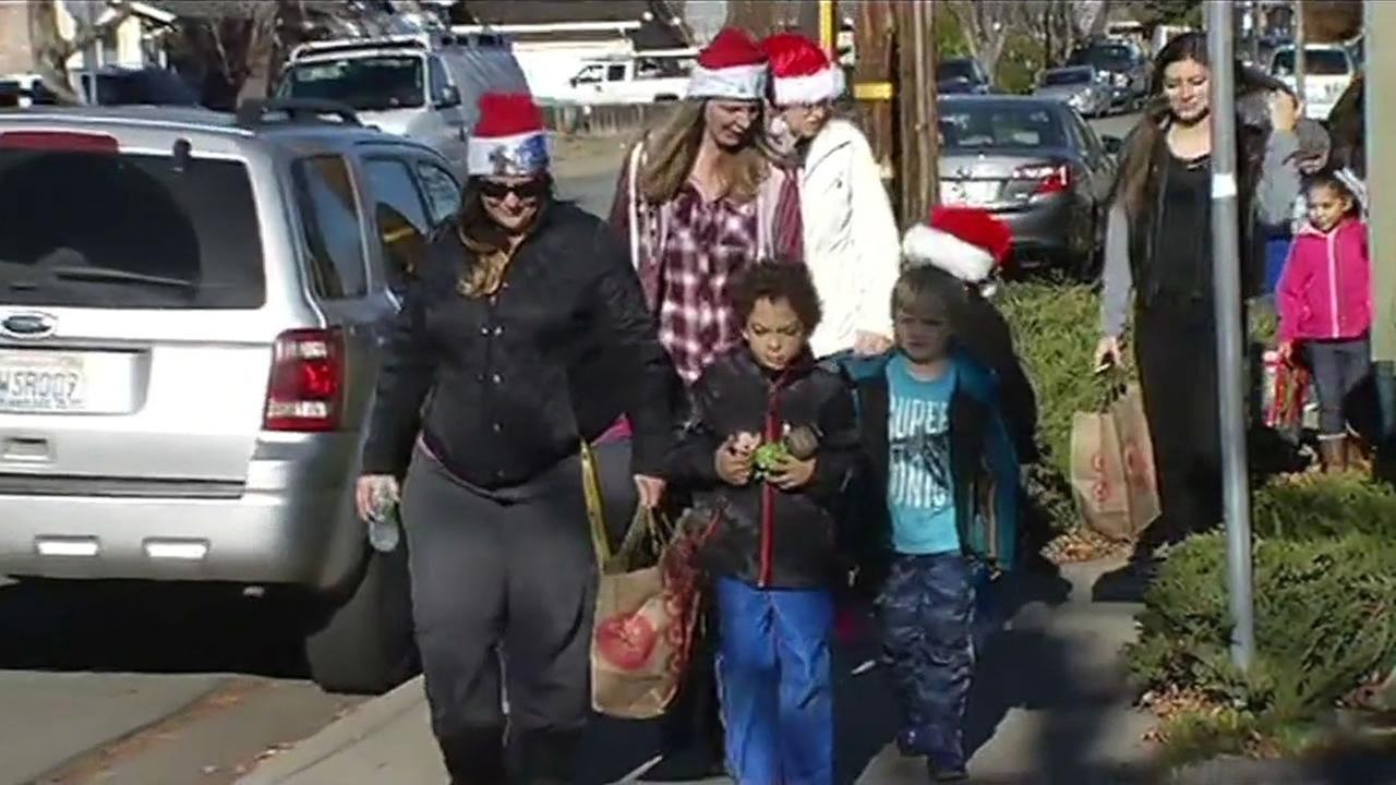 San Jose, Calif. parents pulled their kids out of school to take a walking field trip to the Big E Cafe to visit Santa on Friday, December 18, 2015.