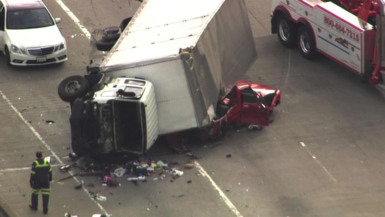 A box truck crashed into a red pickup truck which sparked a multi-car crash near the Bay Bridge Friday Dec. 18, 2015.