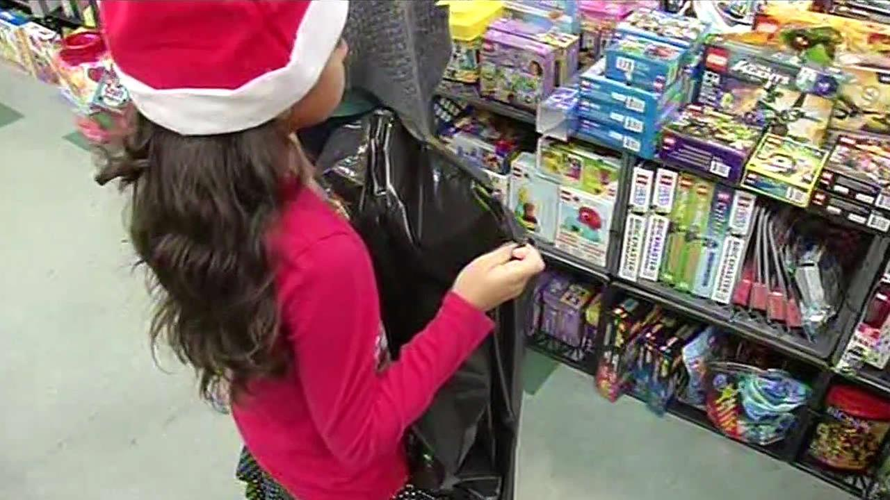 A girl is seen at Sacred Heart Community Services toy giveaway in San Jose, Calif. on December 22, 2015.