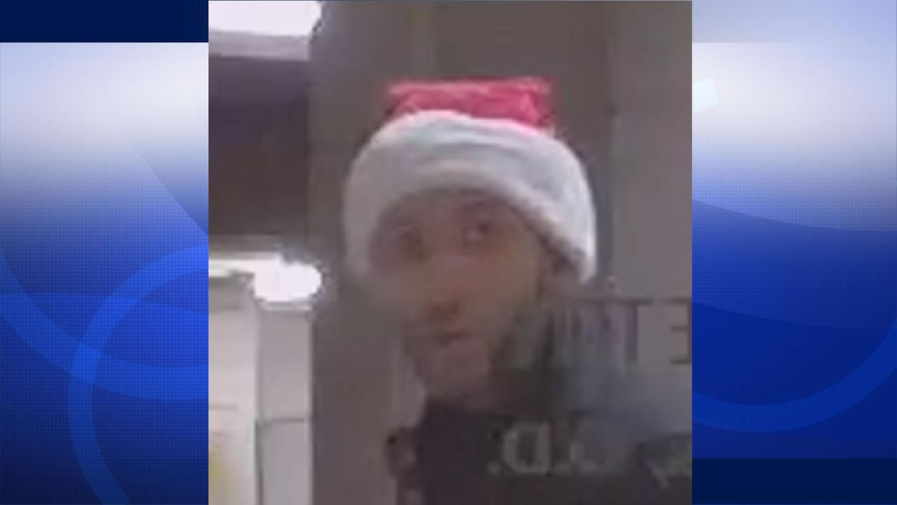 Police in Hillsborough are searching a man wearing a Santa Claus suspected of burglarizing a home and  business Dec. 25, 2015.