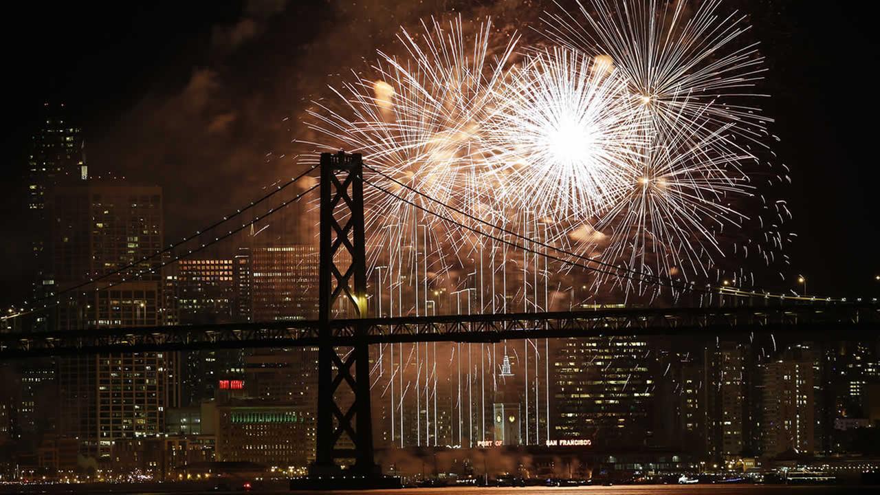 Fireworks light up the sky over the Bay Bridge