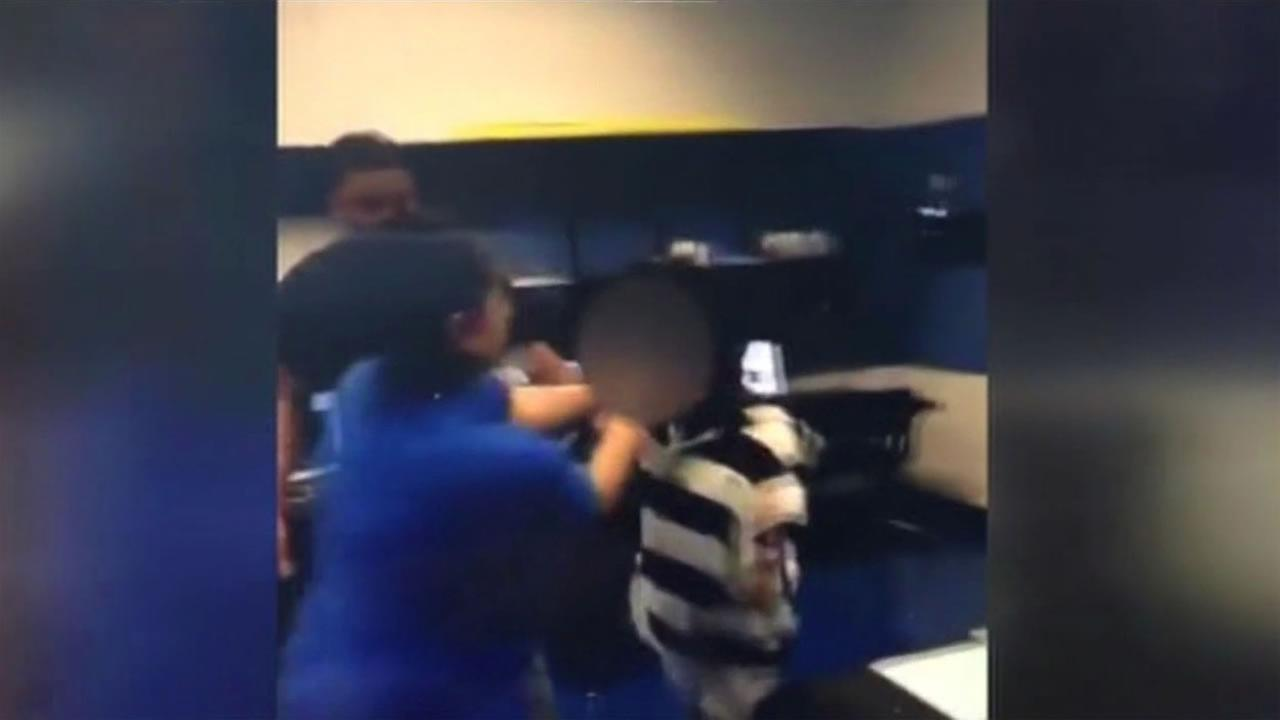 This image is a still from video shot at Tobinworld Academy in Antioch, Calif.Tuesday, January 5, 2016 and shows a teachers aide assaulting a 9-year-old student.
