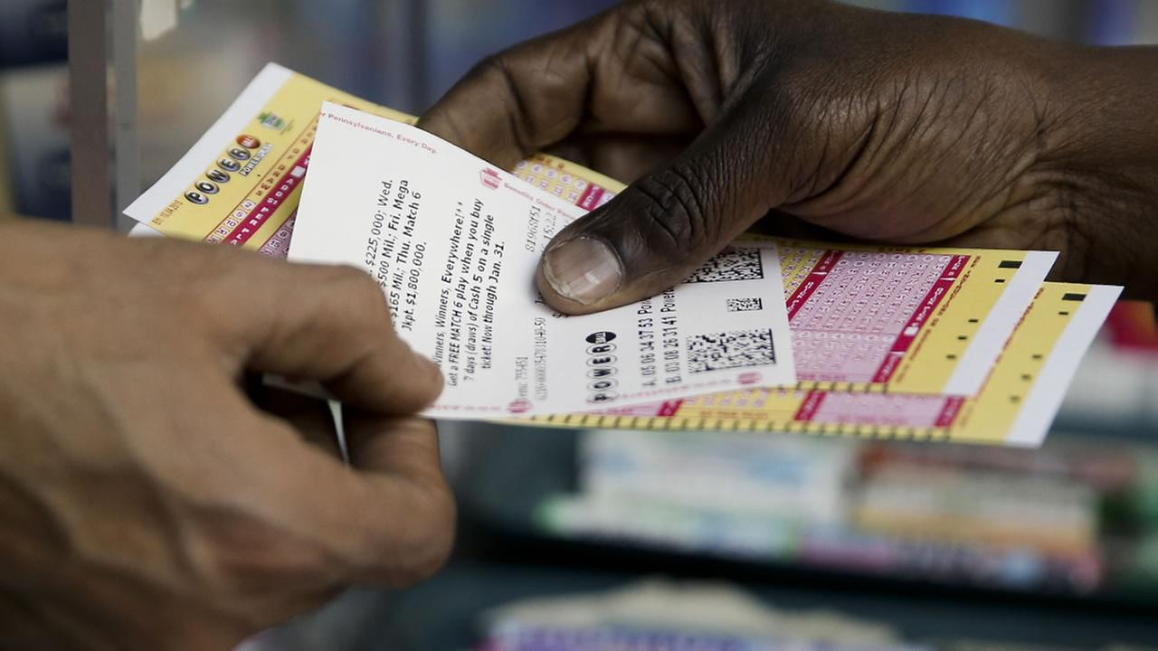 A person purchase Powerball lottery tickets from a newsstand Wednesday, Jan. 6, 2016, in Philadelphia.