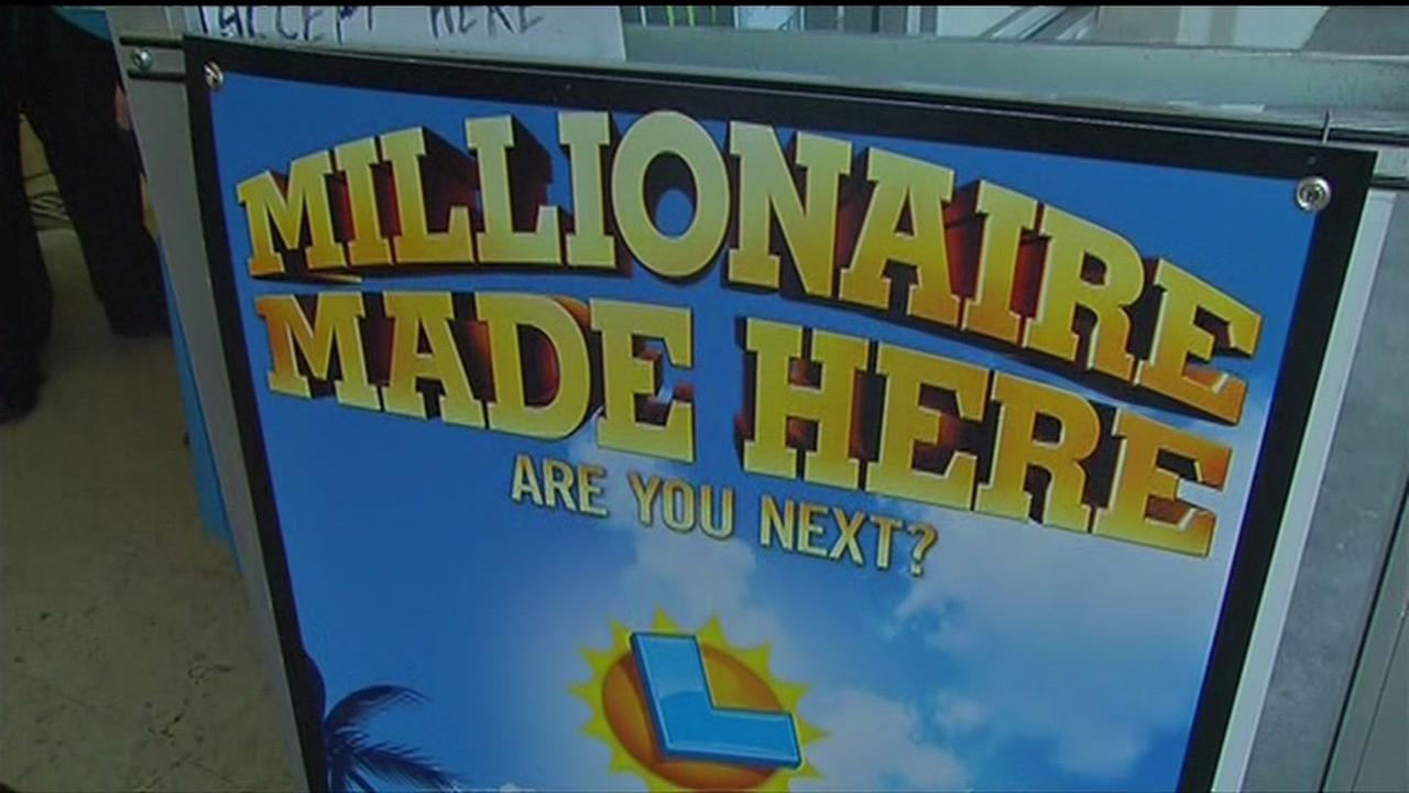 A Millionaire Made Here sign is seen at Perrys Liquor in Union City, Calif. on Thursday, January 7, 2016.