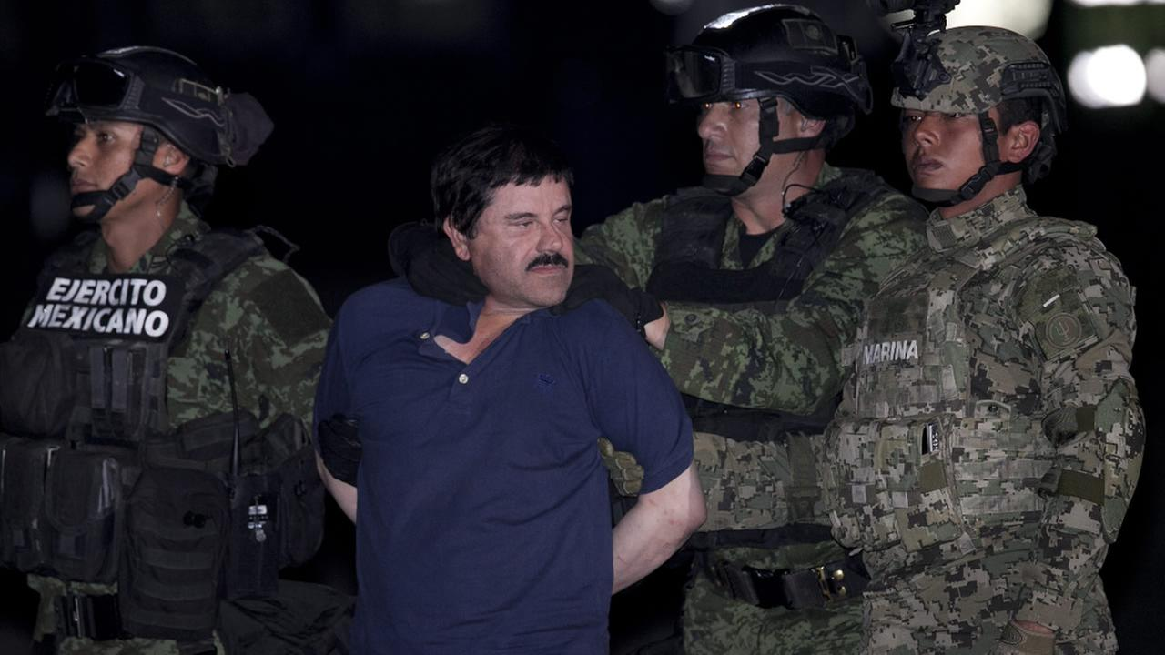 Joaquin El Chapo Guzman is made to face the press as he is escorted to a helicopter in handcuffs by Mexican soldiers and marines at a federal hangar in Mexico City, Mexico, Friday, Jan. 8, 2016.