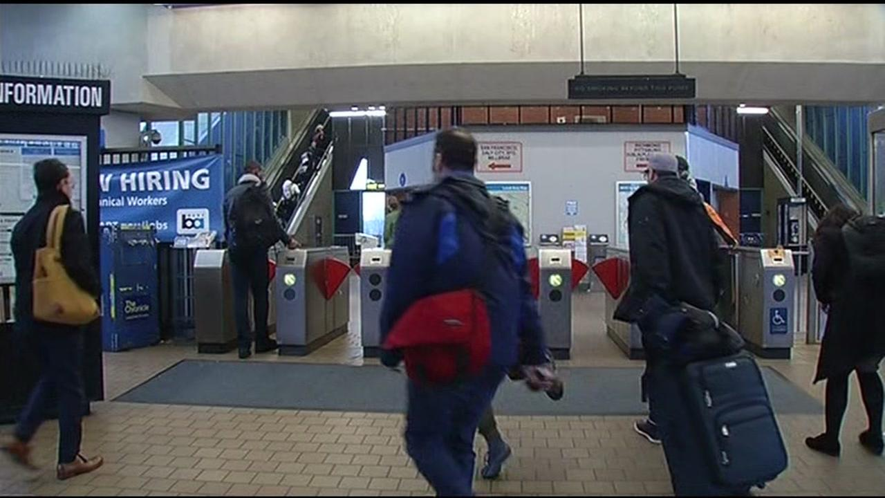 Commuters enter the BART station in West Oakland, Calif. on Monday, January 11, 2016.
